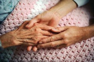 hands caring for a person with Lewy Body Dememtia
